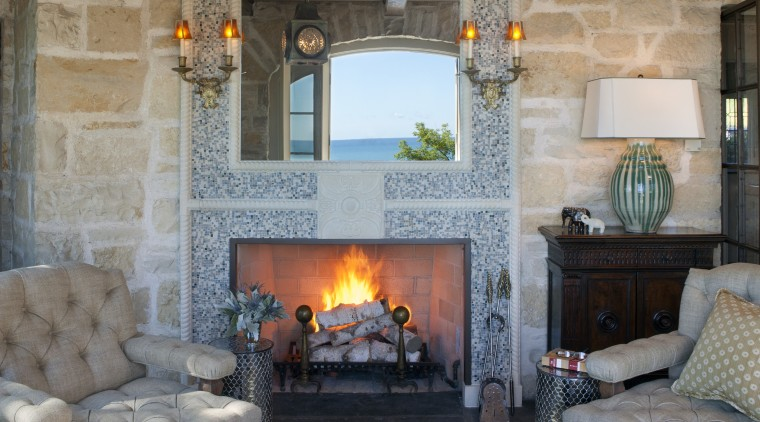 Seen here is a home that's interior was fireplace, hearth, home, interior design, living room, room, wall, gray