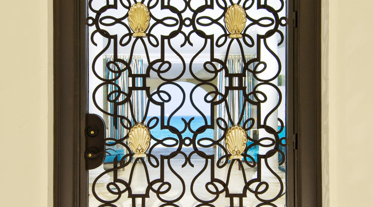 This home was designed by Geoffrey Bradfield. Here glass, iron, stained glass, window, yellow, brown