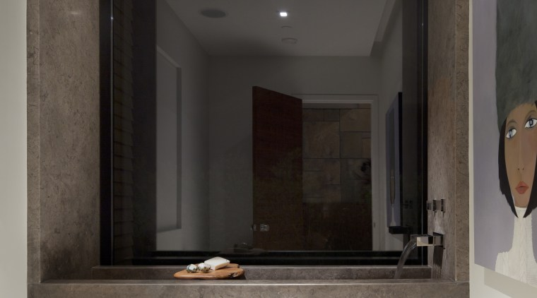 This is a home that was designed by bathroom, floor, interior design, room, gray, black
