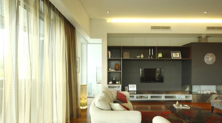 Living area with white furnature and polished floors ceiling, floor, flooring, hardwood, interior design, living room, real estate, room, wall, wood flooring, orange, brown, yellow