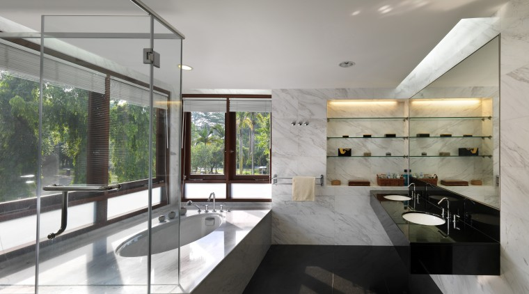 The graceful oval of the tub surround is architecture, countertop, house, interior design, kitchen, real estate, gray