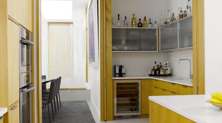 Seen here is a kitchen designed by Geoffrey architecture, cabinetry, countertop, cuisine classique, floor, flooring, house, interior design, kitchen, room, wood flooring, white, orange