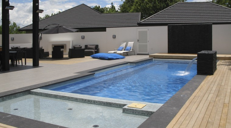 Overlook of pool with chairs. house, leisure, property, real estate, roof, swimming pool, water, gray