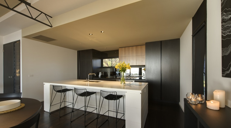 Spacious kitchen shot. architecture, ceiling, countertop, interior design, kitchen, real estate, room, black