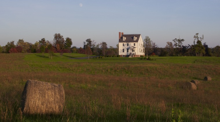 This home was built by Tom Glass of cloud, farm, farmhouse, field, grass, grass family, grassland, hill, house, land lot, meadow, pasture, plain, prairie, rural area, sky, tree, village, brown