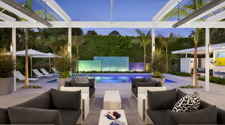 View of the pool and patio areas.  estate, interior design, property, real estate, resort, villa, gray