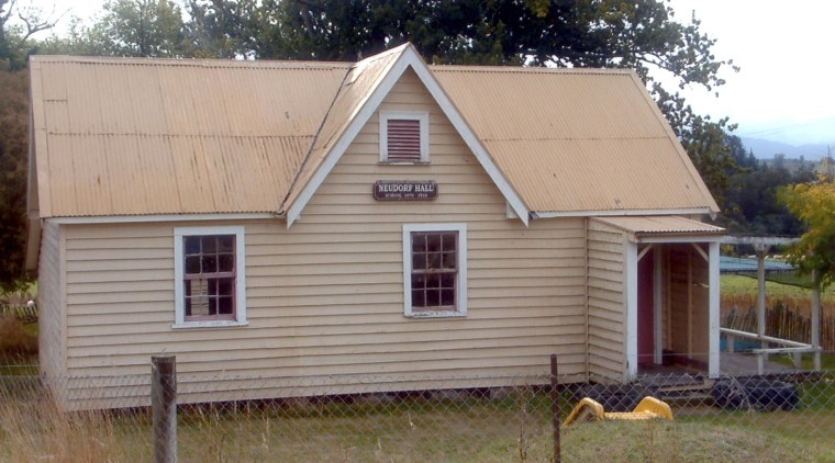 Exterior view cottage, facade, farmhouse, home, house, hut, log cabin, property, real estate, roof, shed, siding, wood, gray