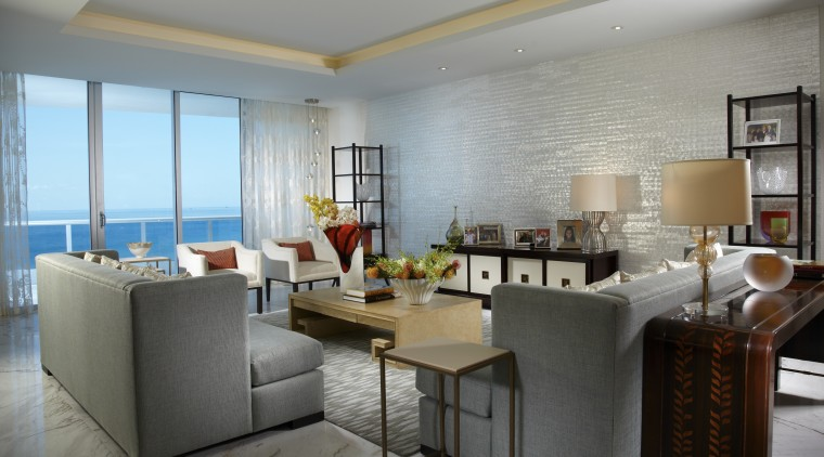 A mother-of-pearl wall by Maya Romanoff is a dining room, interior design, living room, real estate, room, table, gray