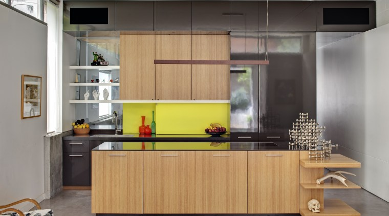 Above left: A vibrant yellow splashback provides a cabinetry, countertop, furniture, interior design, kitchen, gray