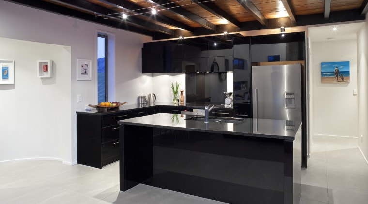 This kitchen, designed by the owner in conjunction countertop, interior design, kitchen, black, white