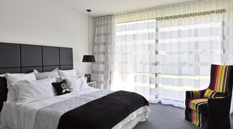 Seen here is a GJ Gardner Home in bed frame, bedroom, ceiling, curtain, home, interior design, property, real estate, room, suite, textile, wall, window, window blind, window covering, window treatment, gray, white