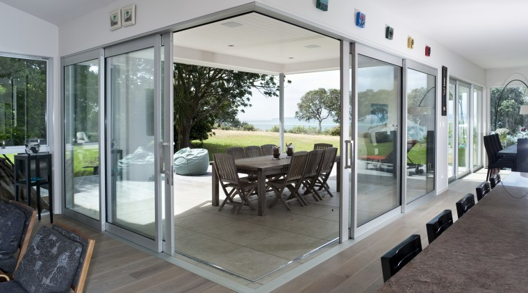 Seen here is joinery designed by Able Aluminium, door, floor, house, interior design, real estate, window, gray