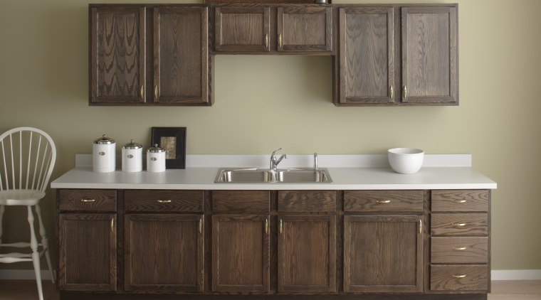 Seen here is a kitchen with a Kohler bathroom, bathroom accessory, bathroom cabinet, cabinetry, chest of drawers, countertop, cuisine classique, furniture, hardwood, kitchen, product design, sink, wood stain, brown