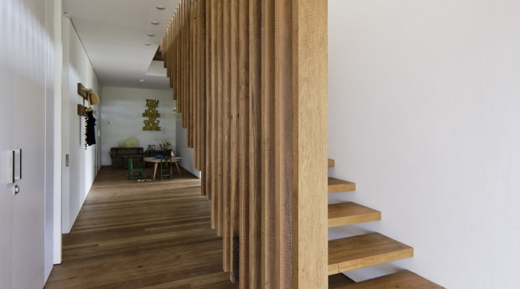 Slats from the kitchen island above extend down architecture, daylighting, floor, flooring, handrail, hardwood, house, interior design, laminate flooring, stairs, wood, wood flooring, brown, gray
