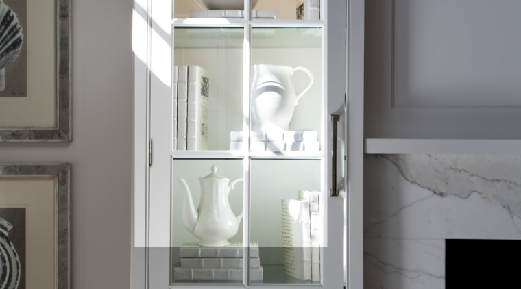 A close up view of kitchen cabinetry from cabinetry, display case, door, furniture, home, interior design, room, sash window, shelf, shelving, wall, window, gray