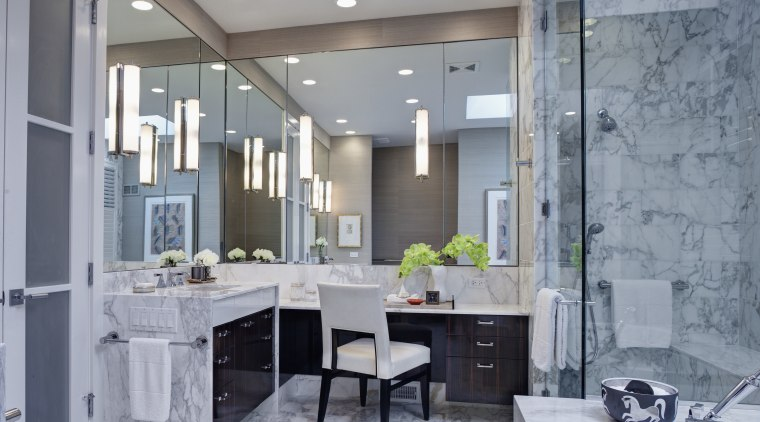 Mirrors wrap around two walls of this remodeled bathroom, ceiling, home, interior design, room, gray