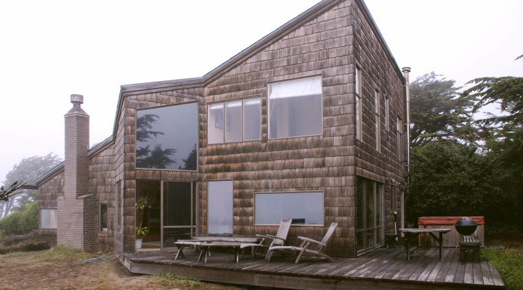 Before the remodeling, this seaside house was in architecture, building, cottage, facade, home, house, property, white, brown