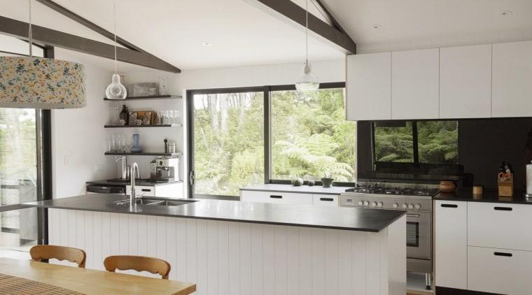 City meets country at Karaka Lakes countertop, cuisine classique, interior design, kitchen, real estate, gray
