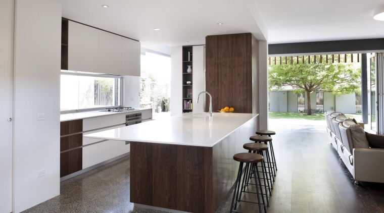 White lacquered cabinets are contrasted by walnut veneer countertop, floor, flooring, house, interior design, kitchen, real estate, room, gray