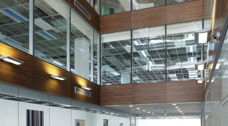 A large glass-walled atrium provides transparency at the architecture, building, ceiling, daylighting, glass, lobby, gray