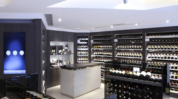 The counter in the Boreaux etc wine store electronics, liquor store, product, retail, white, black