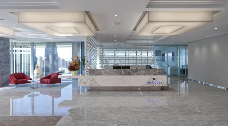 Designphase DBA evoked the standing of Trafigura through ceiling, daylighting, floor, flooring, interior design, lobby, gray