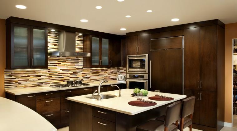 Understated dark wood cabinetry and cream countertops are cabinetry, countertop, cuisine classique, interior design, kitchen, orange, red