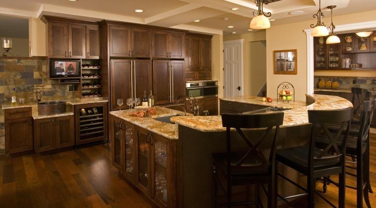 This spacious entertainer's kitchen designed by Richard Landon cabinetry, countertop, cuisine classique, flooring, hardwood, interior design, kitchen, room, wood flooring, brown