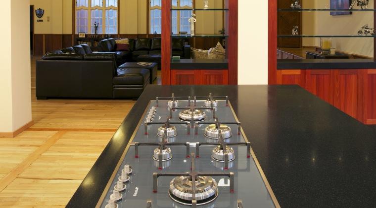 Smeg cooking appliances in new kitchen floor, flooring, interior design, table, orange, black