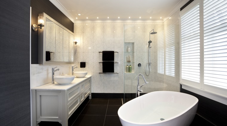 In this master bathroom, walls feature large tiles bathroom, home, interior design, property, real estate, room, sink, window, white, black