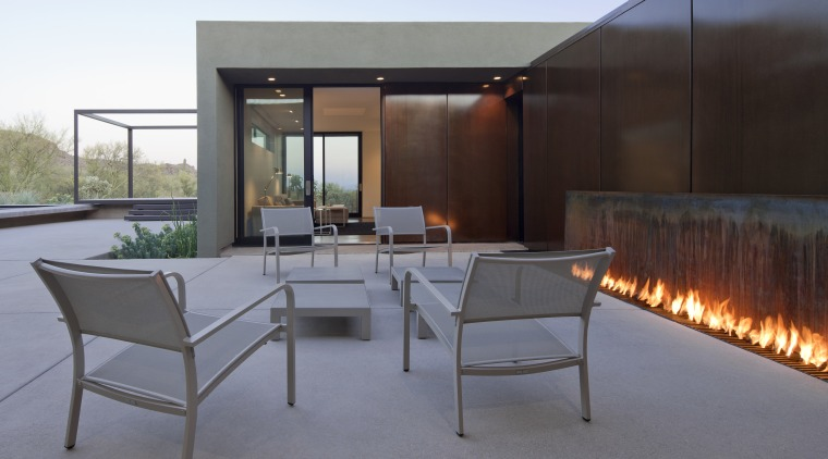 Alfresco living in this desert house is enhanced architecture, furniture, house, interior design, real estate, roof, table, gray