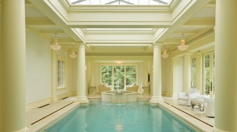 This pavilion-style indoor pool is flooded with natural ceiling, column, daylighting, estate, home, interior design, lobby, property, real estate, structure, swimming pool, thermae, window, orange