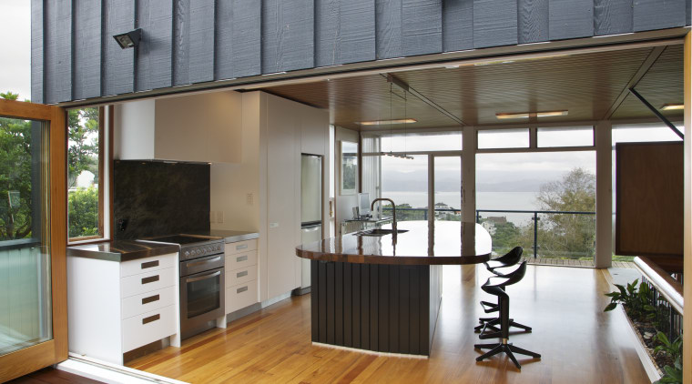 Large bifold doors open up this new kitchen deck, door, house, interior design, real estate, window, gray, brown
