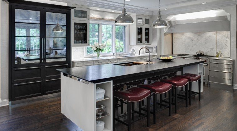 This Mick De Giulio  kitchen responds to cabinetry, countertop, cuisine classique, floor, flooring, interior design, kitchen, room, table, gray, black