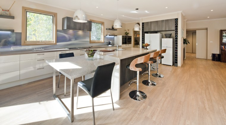 It's what's behind the scenes that determines the countertop, floor, flooring, hardwood, interior design, kitchen, laminate flooring, property, real estate, room, wood, wood flooring, gray