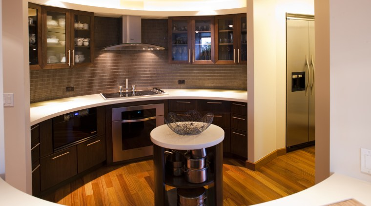 This kitchen with an Asian influence has an cabinetry, countertop, floor, flooring, interior design, kitchen, room, orange, brown