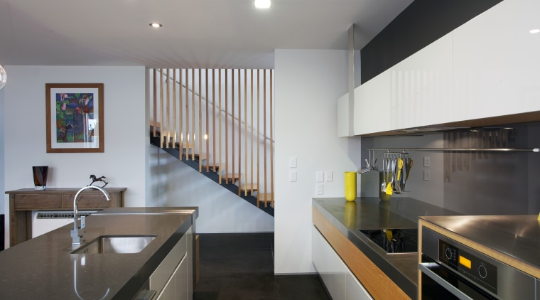 This kitchen designed by Melanie Craig Design features architecture, countertop, interior design, kitchen, real estate, gray, black