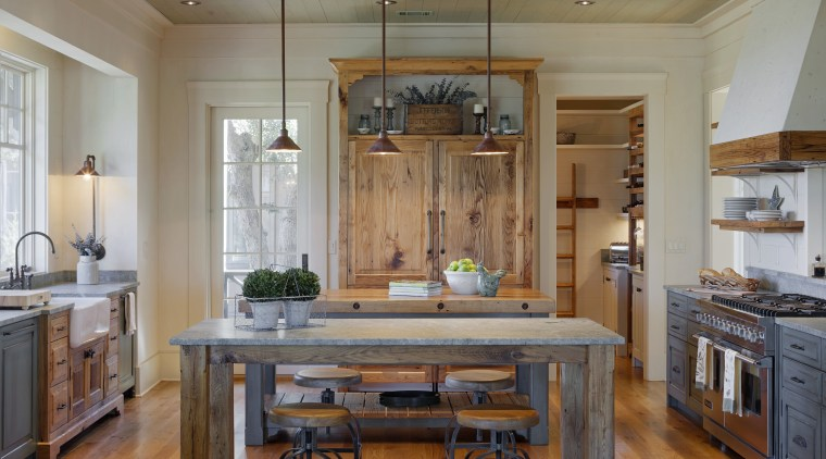 Traditional character defines this kitchen in a new cabinetry, ceiling, countertop, cuisine classique, dining room, floor, flooring, hardwood, home, interior design, kitchen, laminate flooring, living room, real estate, room, table, wood, wood flooring, wood stain, gray, brown