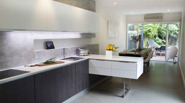 The peninsula is supported by concealed steel and architecture, countertop, interior design, kitchen, real estate, gray