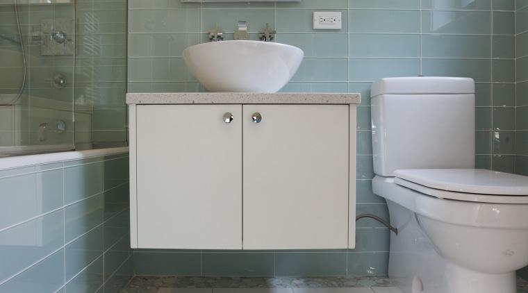Apartment bathroom renovation bathroom, bathroom accessory, bathroom cabinet, daylighting, floor, flooring, home, interior design, product design, property, room, sink, tile, gray