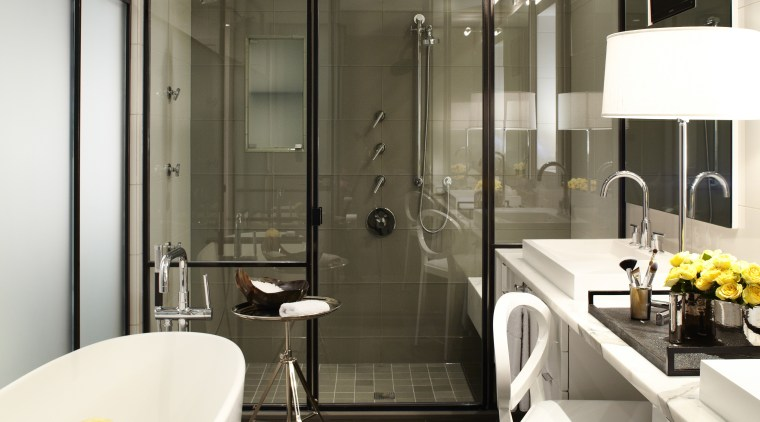 The shower occupies the full width of the bathroom, countertop, floor, interior design, kitchen, sink, white, black