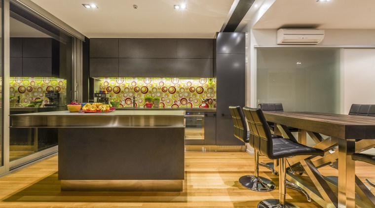Mal Corboy kitchen with Smeg appliances.  Black countertop, flooring, interior design, kitchen, real estate, room, brown, orange