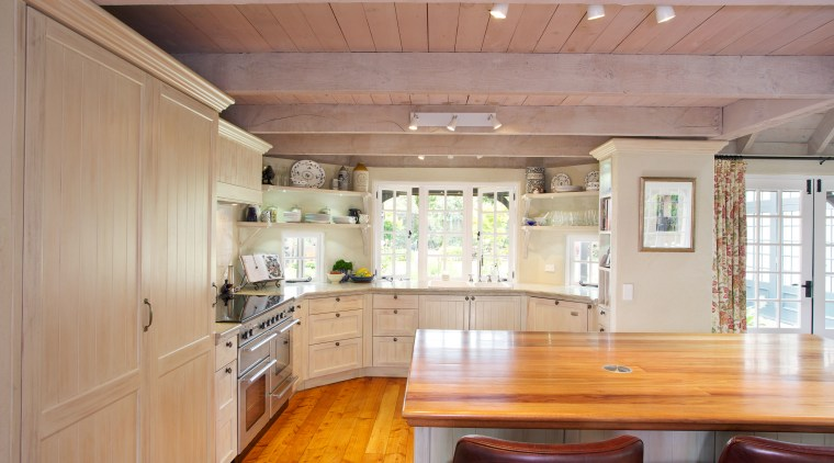 Open shelving provides extra storage and gives a cabinetry, ceiling, countertop, cuisine classique, estate, floor, hardwood, home, house, interior design, kitchen, property, real estate, room, wood, wood flooring, gray, orange
