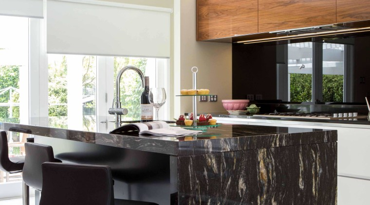 Benchtop with dark and bold stone top with countertop, cuisine classique, furniture, interior design, kitchen, table, white