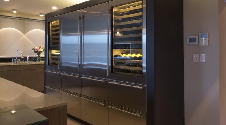Sleek, contemporary German kitchen cabinetry, home appliance, interior design, kitchen, kitchen appliance, major appliance, refrigerator, black, brown