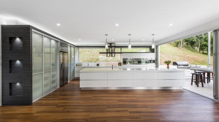 Sleek contemporary kitchen with Smeg appliances countertop, floor, flooring, hardwood, house, interior design, kitchen, laminate flooring, real estate, wood flooring, white