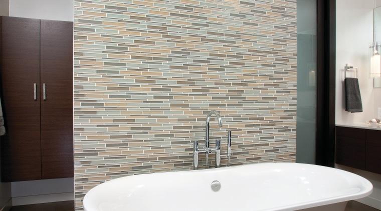 A Victoria & Albert bathtub is the centerpiece architecture, bathroom, floor, flooring, home, interior design, plumbing fixture, room, sink, tap, tile, wall, gray