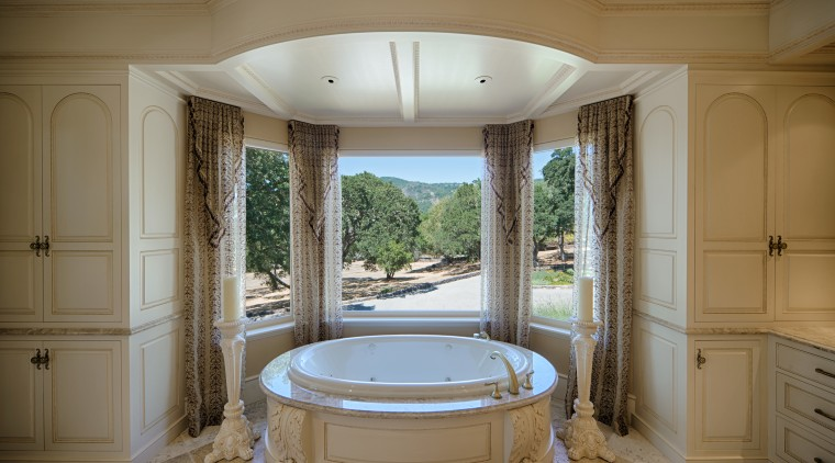 An MTI Whirlpools tub sits in front of bathroom, bathtub, estate, home, interior design, real estate, room, window, brown, gray