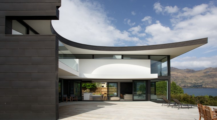 The elliptical decks, overhangs and roof forms of architecture, facade, home, house, property, real estate, black, gray