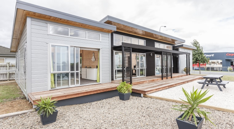 Lockwood Skagen show home featuring a raised roof facade, home, house, property, real estate, white